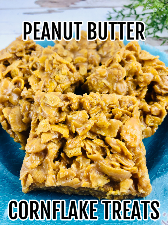 Peanut Butter Cornflake Treats on a blue dessert plate