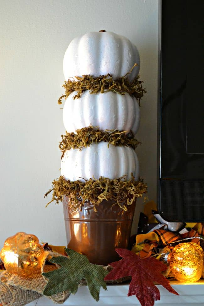 This quick and easy 3 tiered pumpkin topiary craft is perfect to add a touch of fall to your home all for around $5 total.