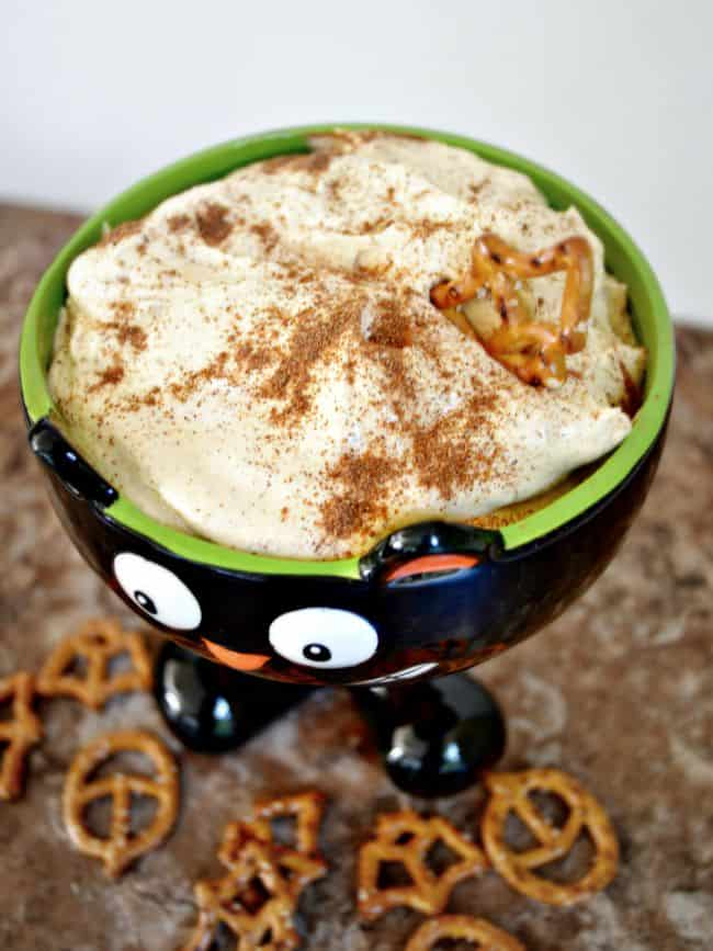 This creamy pumpkin cheesecake dip is perfect for your next fall party. It whips up in less than 10 minutes and you are good to go. Great with salty pretzels, apples and more.