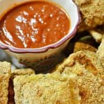 These baked ravioli appetizers are perfect for your holiday or game day parties. Very similar to Olive Garden's toasted ravioli's. So yummy and broiled for a crispy goodness.