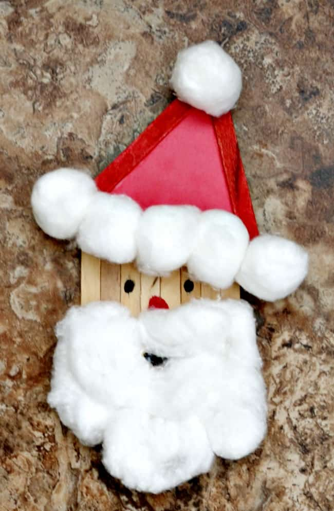 While your kids are waiting for Santa how about creating Santa with this really cute Popsicle Stick Santa craft. All you need is a few simple supplies.