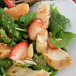This Strawberry Orange Grilled Chicken Salad is so simple and delicious. A livened up version of a regular ole salad with bright and colorful fruit for a spicy and sweet taste.