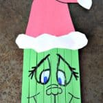 Create this super cute Popsicle Stick Grinch with your kids this holiday season. A perfect pairing with the classic book and movie.