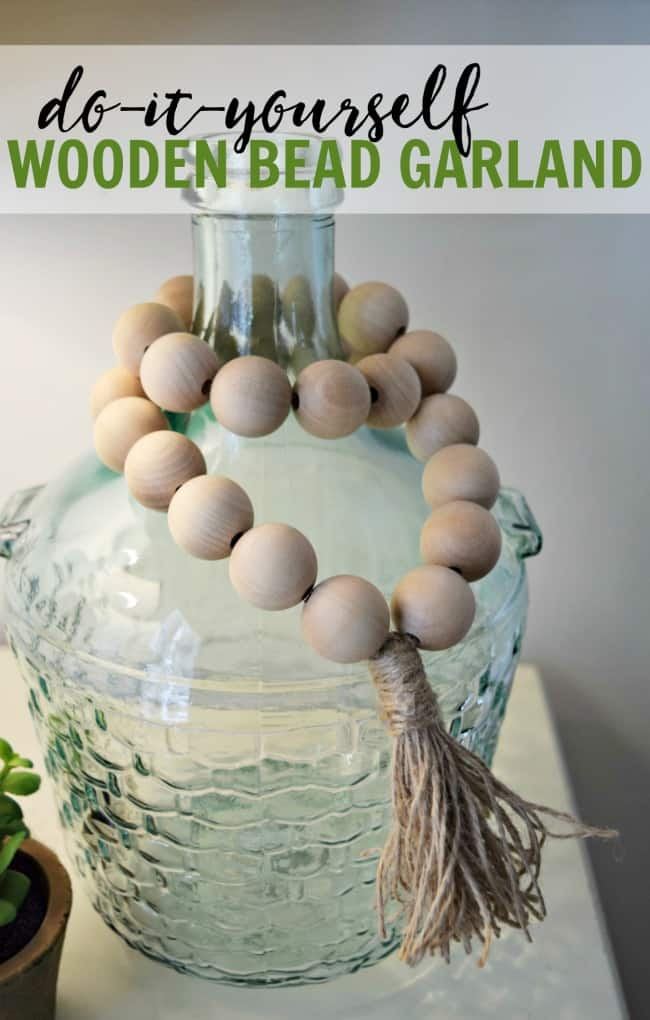 How to create your own wooden bead garlands for less than $10. Super cute and simple home decor project that only requires a couple materials.  #woodenbeads #DIY #WoodenBeadGarland