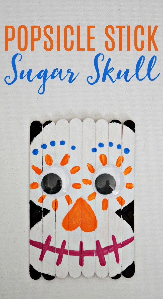 Celebrate the Day of the Dead with this fun and colorful Popsicle Stick Sugar Skull. A great craft for the new Disney movie, Coco!  #Halloween #PopsicleStickCrafts #kidcrafts #sugarskull #DayoftheDead #CoComovie #Disney