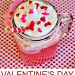 Pink Valentine's Day Punch in a mason jar with red and pink heart sprinkles