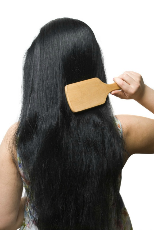 Female Brushing her long dark hair