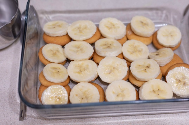 Classic Southern Banana Pudding starts with layering Nilla wafers and perfectly ripe banana slices. Topped with delicious homemade vanilla pudding.