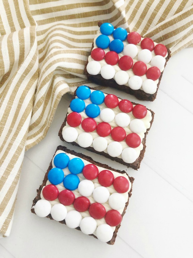 Patriotic Flag Brownies on a striped tea towel and white background.