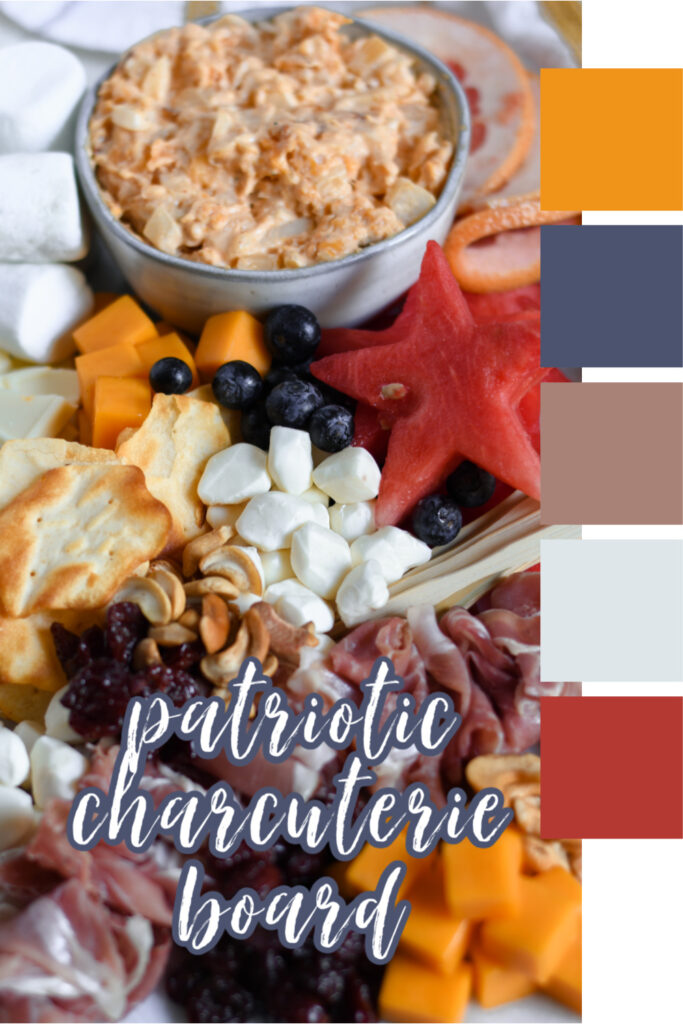 This photo features a marble slab with various red, white, and blue foods to create a beautiful patriotic charcuterie board for the 4th of July.