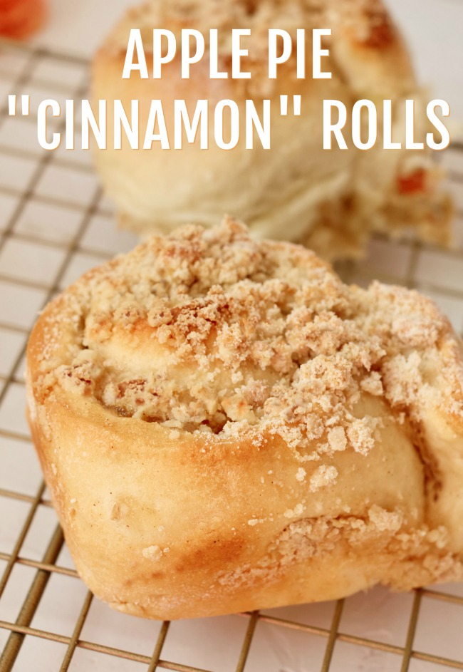 "This photo features Apple Pie ""Cinnamon"" Rolls cooling on a wire rack."