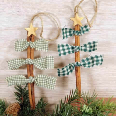 This photo features scrap fabric christmas tree ornaments perfect for holiday crafting also using cinnamon sticks and wooden stars.