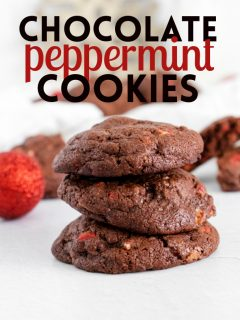 This photo features a stack of chocolate peppermint cookies with the same label at the top. In the background you can see additional cookies and a few red Christmas balls for props.