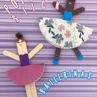 This photo features a purple striped background with the popsicle stick ballerina girls displayed on top.