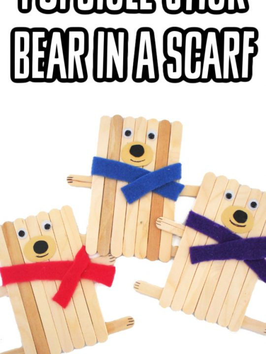 This photo features 3 popsicle stick bear crafts in colorful scarfs.