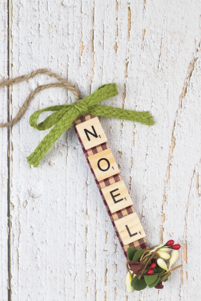 This photo features a sample of the scrabble tile Christmas ornaments