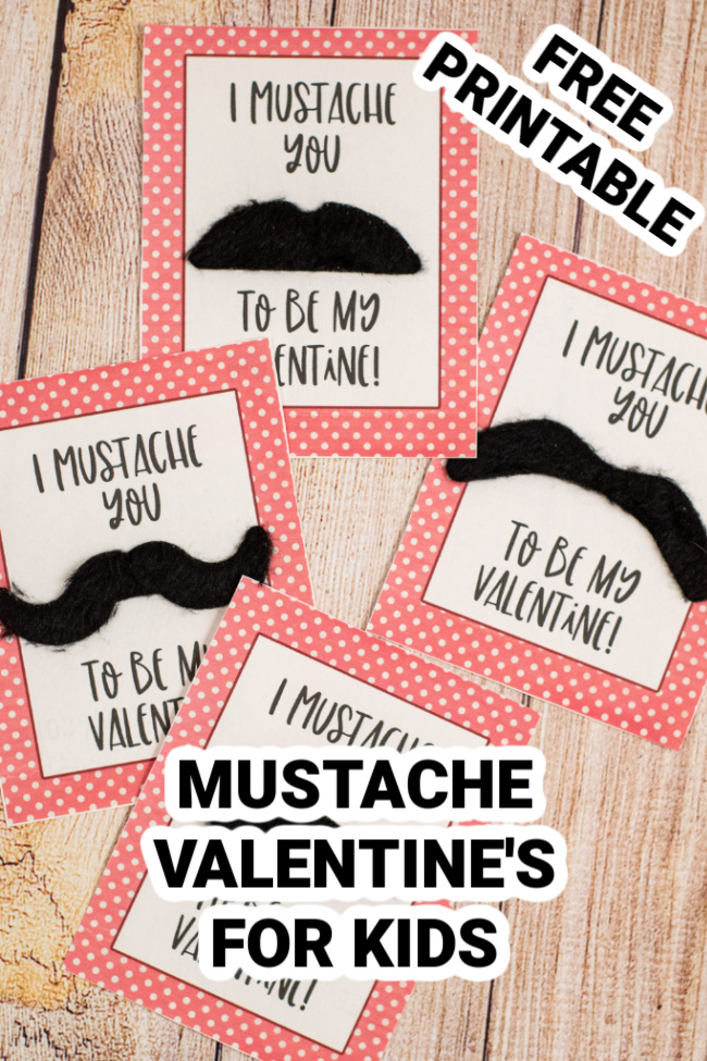 This photo features a wooden background with printed mustache valentines for kids that say I mustache you to be my Valentine.