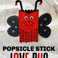 This photo features a created popsicle stick love bug valentine craft.