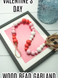 This photo features a made wood bead garland painted up for Valentine's Day.