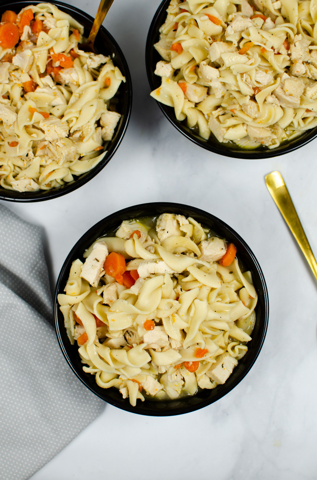This photo features a few bowls of the Instant Pot Chicken Noodle Soup.
