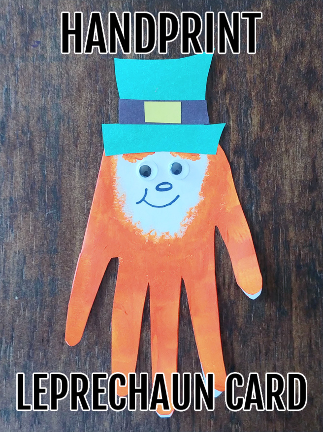 A crafted handprint leprechaun card on a wood background