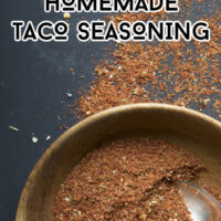 Bowl of homemade taco seasoning on a dark background