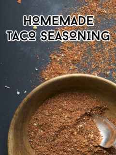 Bowl of homemade taco seasoning on a dark background