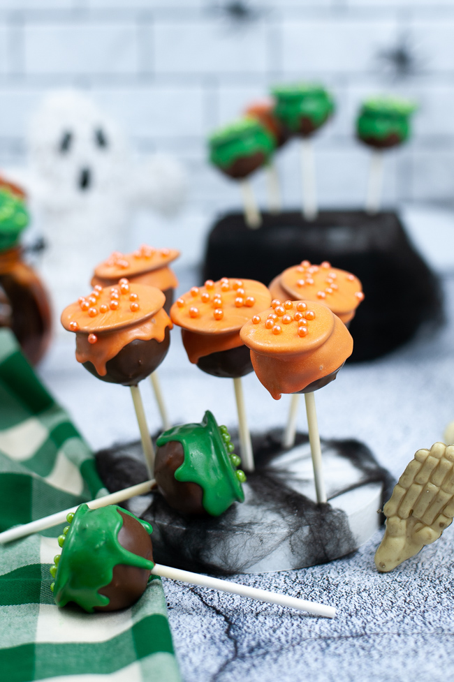 Cauldron Cake Pops done in orange and green icing