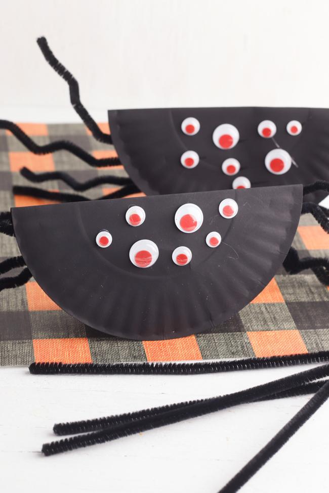 Paper Plate Rockin' Spider Craft on a black and orange background.